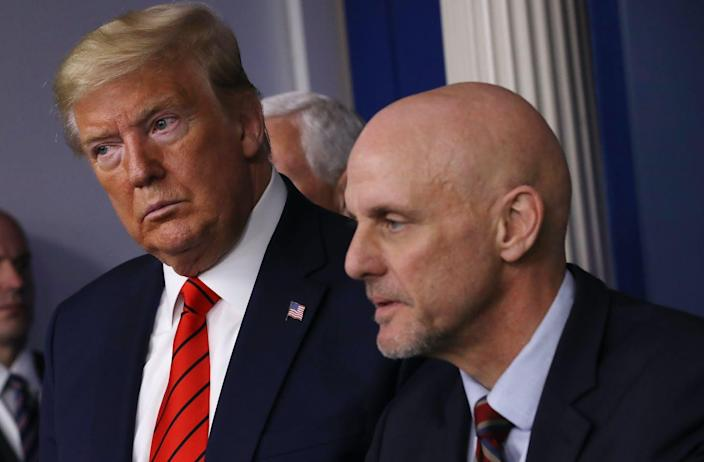 "<span class=""caption"">FDA Commissioner Stephen Hahn, right, and President Trump at a Coronavirus Task Force meeting March 19, 2020.</span> <span class=""attribution""><a class=""link rapid-noclick-resp"" href=""https://www.gettyimages.com/detail/news-photo/president-donald-trump-listens-to-fda-commissioner-stephen-news-photo/1213540766?adppopup=true"" rel=""nofollow noopener"" target=""_blank"" data-ylk=""slk:Chip Somodevilla/Getty Images"">Chip Somodevilla/Getty Images</a></span>"