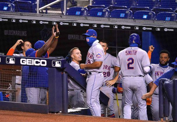 PHOTO: The New York Mets celebrate in the dugout after Dominic Smith #2 of the New York Mets scores in the eighth inning against the Miami Marlins at Marlins Park, Aug. 19, 2020, in Miami. (Mark Brown/Getty Images)