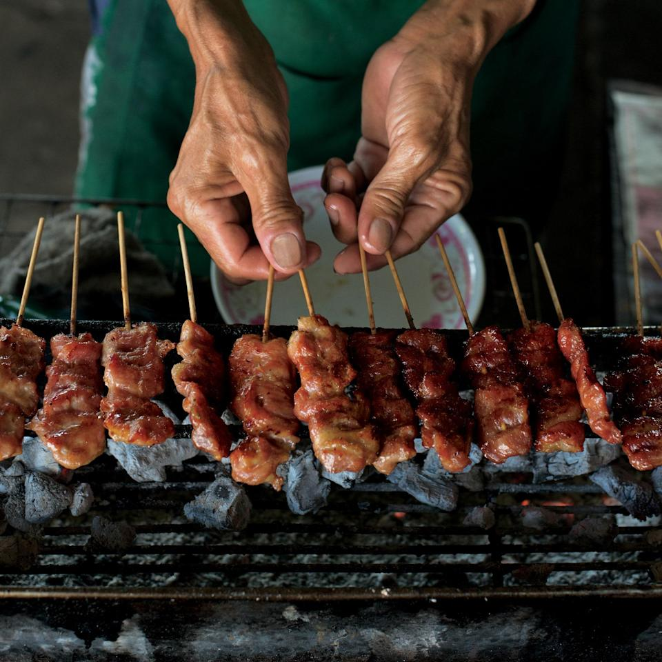 """Sweetened condensed milk balances out the spices in these irresistible skewers from chef Kris Yenbamroong of Night + Market in Los Angeles. <a href=""""https://www.epicurious.com/recipes/food/views/curry-and-coconut-milk-grilled-pork-skewers-56389544?mbid=synd_yahoo_rss"""" rel=""""nofollow noopener"""" target=""""_blank"""" data-ylk=""""slk:See recipe."""" class=""""link rapid-noclick-resp"""">See recipe.</a>"""