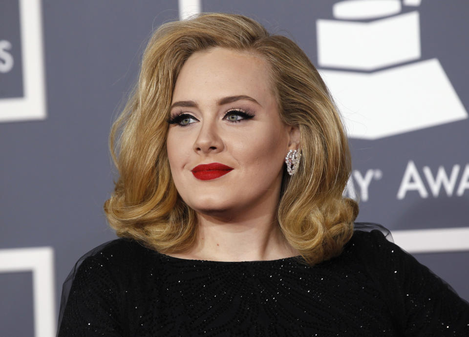 British singer Adele arrives at the 54th annual Grammy Awards in Los Angeles, California February 12, 2012.   REUTERS/Danny Moloshok (UNITED STATES  - Tags: ENTERTAINMENT)  (GRAMMYS-ARRIVALS)