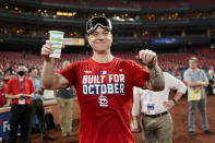 St. Louis Cardinals' Tyler O'Neill celebrates with teammates after defeating the Milwaukee Brewers in a baseball game to clinch a playoff spot Tuesday, Sept. 28, 2021, in St. Louis. (AP Photo/Jeff Roberson)