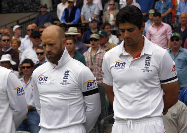 England's captain Alastair Cook (R) and vice-captain Matt Prior stand with the team as they observe a minute of silence to commemorate former South African President Nelson Mandela's death before starting the second day's play in their second Ashes cricket test against Australia at the Adelaide Oval December 6, 2013. South African anti-apartheid hero Mandela died aged 95 at his Johannesburg home on Thursday after a prolonged lung infection, plunging his nation and the world into mourning for a man hailed by global leaders as a moral giant. REUTERS/David Gray (AUSTRALIA - Tags: SPORT CRICKET OBITUARY)
