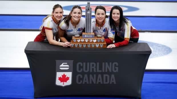 Skip Kerri Einarson, far right, and her Manitoba foursome will get the opportunity to play in the women's world championship in Calgary in April and fight for a spot in the 2022 Beijing Olympics. (Jeff McIntosh/The Canadian Press - image credit)