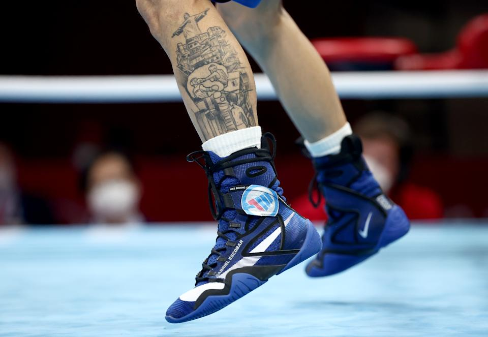 <p>TOKYO, JAPAN - JULY 26: A tatto on the leg of Gabriel Escobar Mascunano of Spain is seen during the Men's Fly (48-52kg) on Day 3 of the Tokyo 2020 Olympic Games at Kokugikan Arena on July 26, 2021 in Tokyo, Japan. (Photo by Buda Mendes/Getty Images)</p>