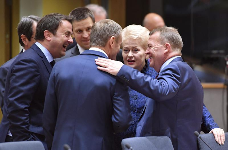 Danish Prime Minister Lars Lokke Rasmussen, right, and Luxembourg's Prime Minister Xavier Bettel, second left, speak with European Council President Donald Tusk, center, during a round table meeting at an EU summit in Brussels on Thursday, March 9, 2017. German Chancellor Angela Merkel threw her weight behind Donald Tusk to retain one of the European Union's top jobs ahead of an EU summit Thursday, despite staunch opposition from his home country of Poland. (AP Photo/Geert Vanden Wijngaert)