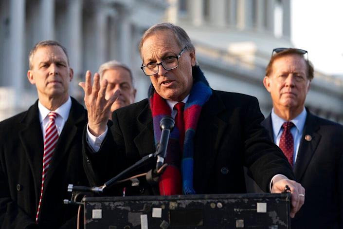 Freedom Caucus chairman Rep. Andy Biggs, R-Ariz., center, speaks next to Rep. Scott Perry, R-Pa., left, and Randy Weber, R-Texas, right, on Capitol Hill on Dec. 3, 2020, in Washington, D.C.