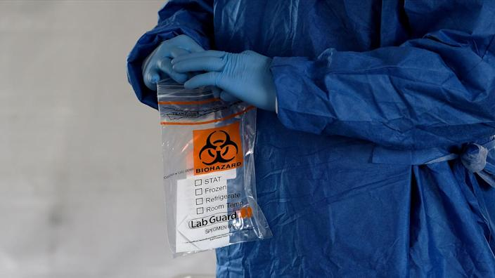 A biohazard bag is used for containing a specimen for a coronavirus disease (COVID-19) test, distributed by the Wisconsin National Guard at the United Migrant Opportunity Services center, as cases spread in the Midwest, in Milwaukee, Wisconsin, U.S., October 2, 2020. (Alex Wroblewski/Reuters)