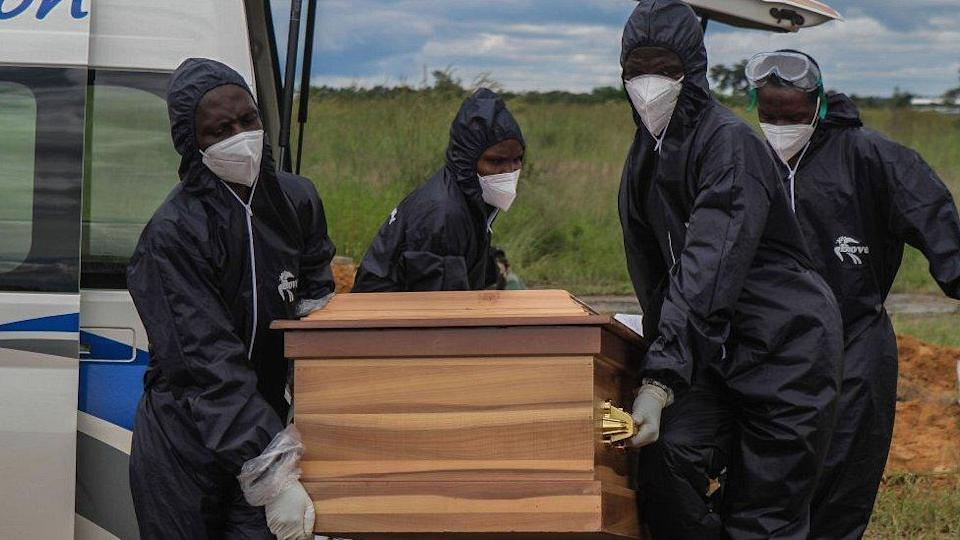 Coffin being carried by funeral workers in Zimbabwe