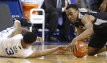 Kentucky's Tyler Ulis (3) and Providence's Jalen Lindsey chase down a loose ball during the first half of an NCAA college basketball game, Sunday, Nov. 30, 2014, in Lexington, Ky. (AP Photo/James Crisp)