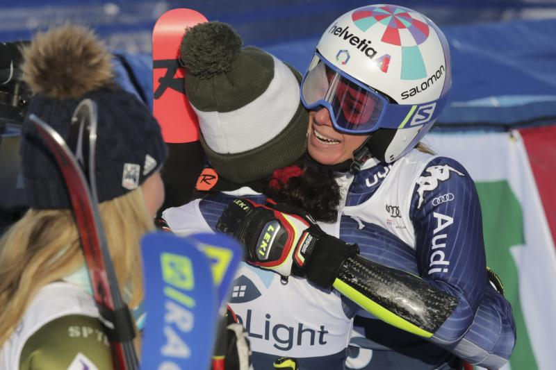 Italy's Marta Bassino, right, hugs second placed teammate Federica Brignone as she celebrates in the finish area after winning an alpine ski, women's World Cup giant slalom in Killington, Vt., Saturday, Nov. 30, 2019. (AP Photo/Charles Krupa)