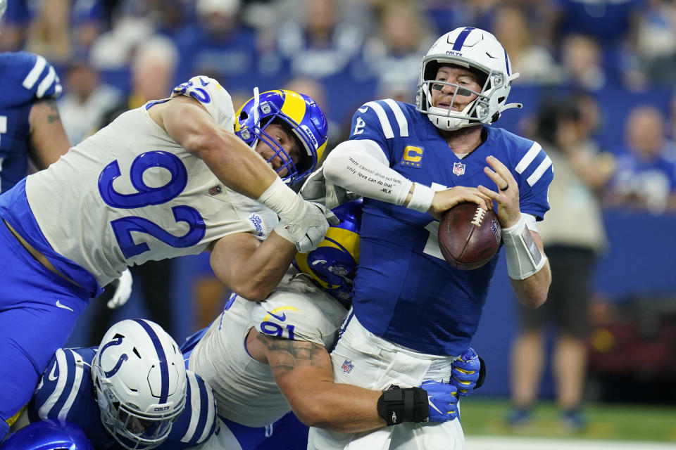 Indianapolis Colts quarterback Carson Wentz (2) is sacked by Los Angeles Rams' Greg Gaines (91) during the first half of an NFL football game, Sunday, Sept. 19, 2021, in Indianapolis. (AP Photo/Michael Conroy)