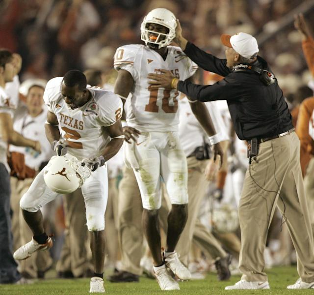 <p>2003 — Midway through his redshirt freshman season at Texas, Vince Young becomes the starting quarterback, ushering in the era of the mega-athlete QB who can both pass and run. By 2005, Young is the first player in FBS history to pass for 3,000 yards and rush for 1,000, while leading the Longhorns to the national championship. Young is followed by a succession of mega-athlete QB Heisman winners: Tim Tebow (2007), Cam Newton (2010), Robert Griffin III (2011), Johnny Manziel (2012), Marcus Mariota (2014), Lamar Jackson (2016) and Kyler Murray (2018). (Photo credit: AP) </p>