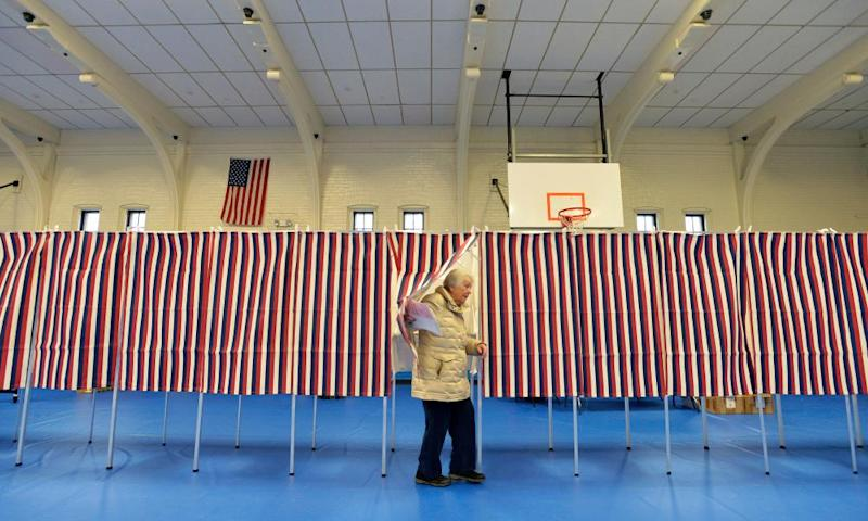 A voter leaves a polling booth during the New Hampshire primary. The OSCE recommended sending 500 observers to monitor the November election.