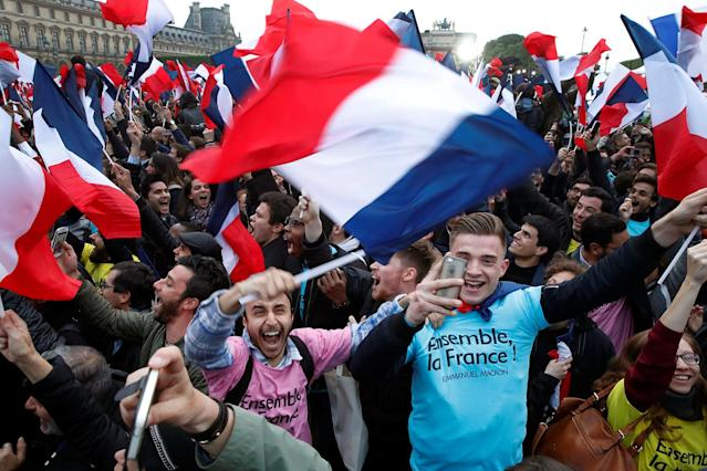 <p>Supporters of French presidential candidate Emmanuel Macron celebrate near the Louvre museum after results were announced in the second-round vote of the 2017 French presidential elections, in Paris, May 7, 2017. (Benoit Tessier/Reuters) </p>