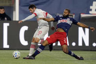 Toronto FC's Alejandro Pozuelo, left, and New England Revolution's Andrew Farrell pursue the ball during the second half of an MLS soccer match, Wednesday, Oct. 7, 2020, in Foxborough, Mass. Toronto FC won 1-0. (AP Photo/Steven Senne)