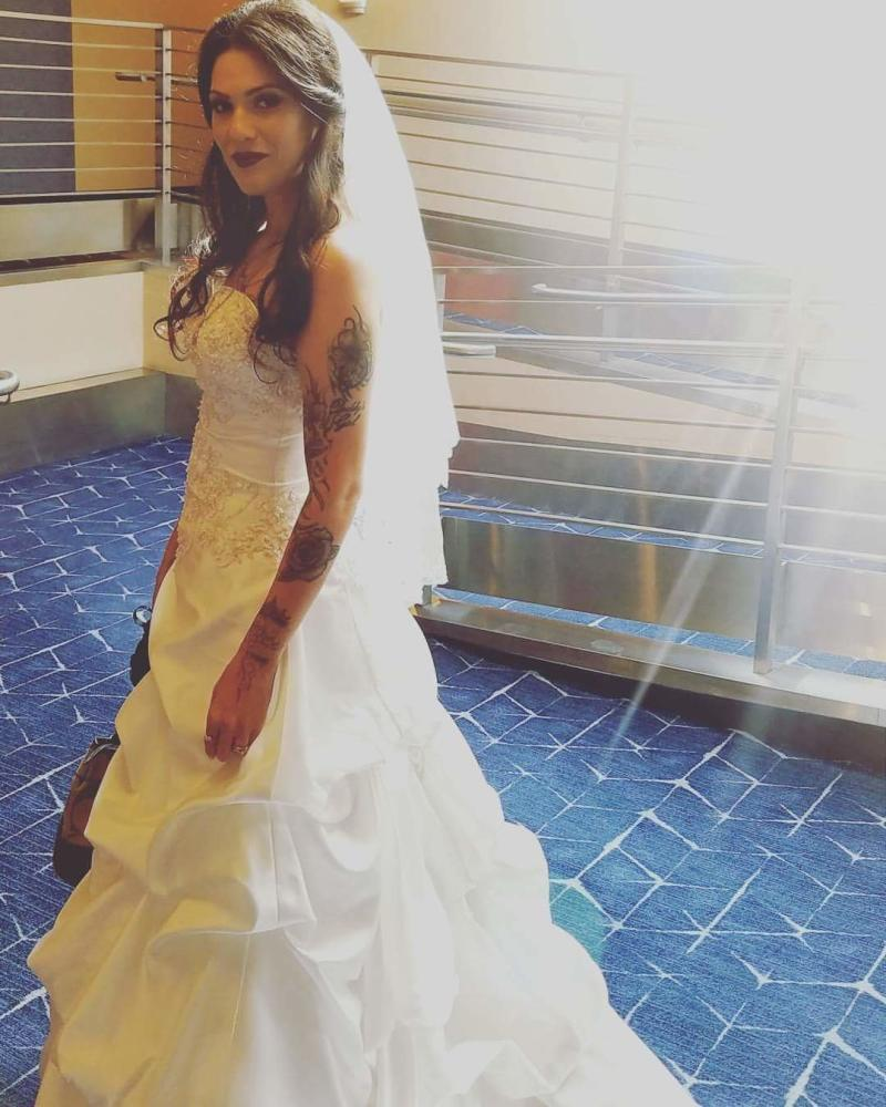 Arianna, who didn't get a traditional wedding experience the first time around, wore the dress to her vow renewal on Wednesday. (Arianna Pro)