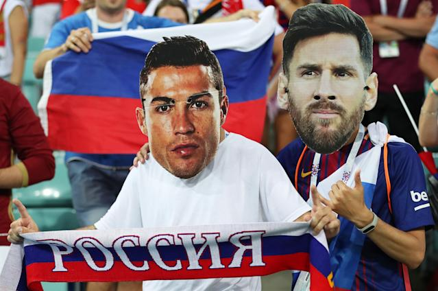 Sochi (Russian Federation), 07/07/2018.- Supporters of Russia wear face masks depicting Cristiano Ronaldo (L) of Portugal and Lionel Messi (R) of Argentina prior to the FIFA World Cup 2018 quarter final soccer match between Russia and Croatia in Sochi, Russia, 07 July 2018. (RESTRICTIONS APPLY: Editorial Use Only, not used in association with any commercial entity - Images must not be used in any form of alert service or push service of any kind including via mobile alert services, downloads to mobile devices or MMS messaging - Images must appear as still images and must not emulate match action video footage - No alteration is made to, and no text or image is superimposed over, any published image which: (a) intentionally obscures or removes a sponsor identification image; or (b) adds or overlays the commercial identification of any third party which is not officially associated with the FIFA World Cup) (Croacia, Mundial de Fútbol, Rusia) EFE/EPA/FRIEDEMANN VOGEL EDITORIAL USE ONLY