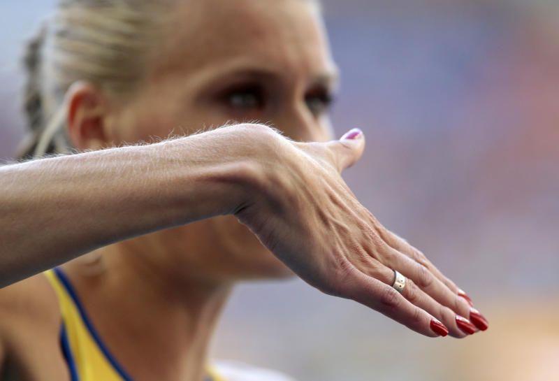 Sweden's Emma Green Tregaro prepares to competes in the women's high jump final at the World Athletics Championships in the Luzhniki stadium in Moscow, Russia, Saturday, Aug. 17, 2013. The Swedish high jumper who sparked a controversy at the world championships by painting her fingernails in the colors of the rainbow to support gay rights took the field Saturday with a bright but politically neutral red instead. Tregaro had been told earlier that the rainbow motif could be a violation of the championships' code of conduct. (AP Photo/Ivan Sekretarev)