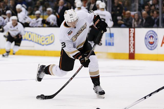 Anaheim Ducks left wing Jakob Silfverberg shoots the puck against the Los Angeles Kings during the third period of an NHL hockey game in Los Angeles, Saturday, March 15, 2014. (AP Photo/Danny Moloshok)