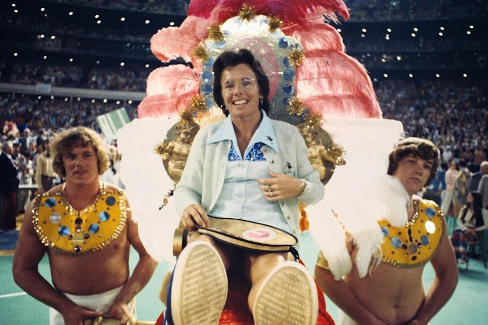 Billie Jean King on gold throne carried by men dressed as ancient slaves. Source: Getty Images