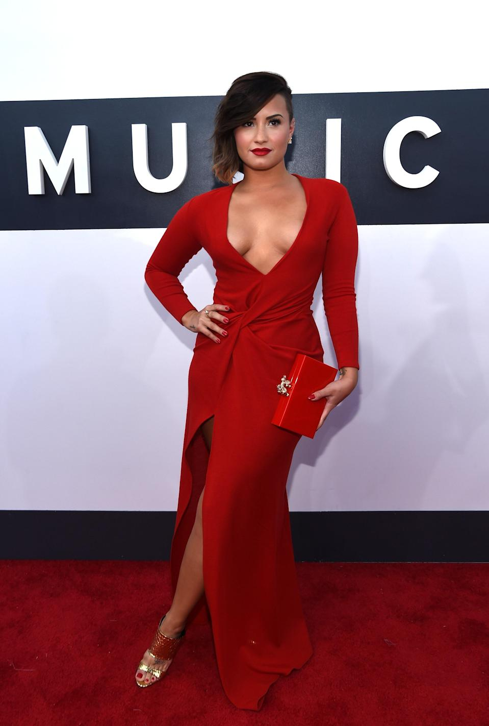 Demi Lovato smoldered in a Lanvin number with a plunging neckline.
