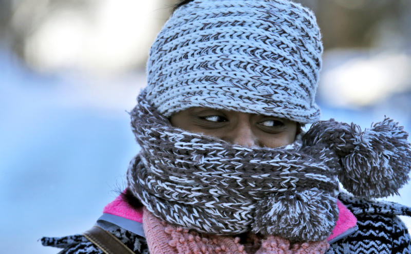 Nyjaii Williams, of St. Paul, is bundled up against the cold wind, Sunday, Jan. 26, 2014, in St. Paul. (AP Photo/The Star Tribune, Marlin Levison) MANDATORY CREDIT; ST. PAUL PIONEER PRESS OUT; MAGS OUT; TWIN CITIES TV OUT