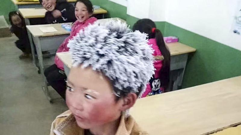 Poor Chinese boy's freezing trek to school touches hearts