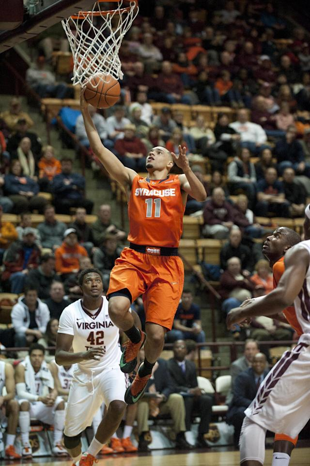 Syracuse's Tyler Ennis (11) goes up for a basket against Virginia Tech's C.J. Barksdale (42) during the first half of an NCAA college basketball game Tuesday, Jan. 7, 2014, in Blacksburg, Va. (AP Photo/Don Petersen)