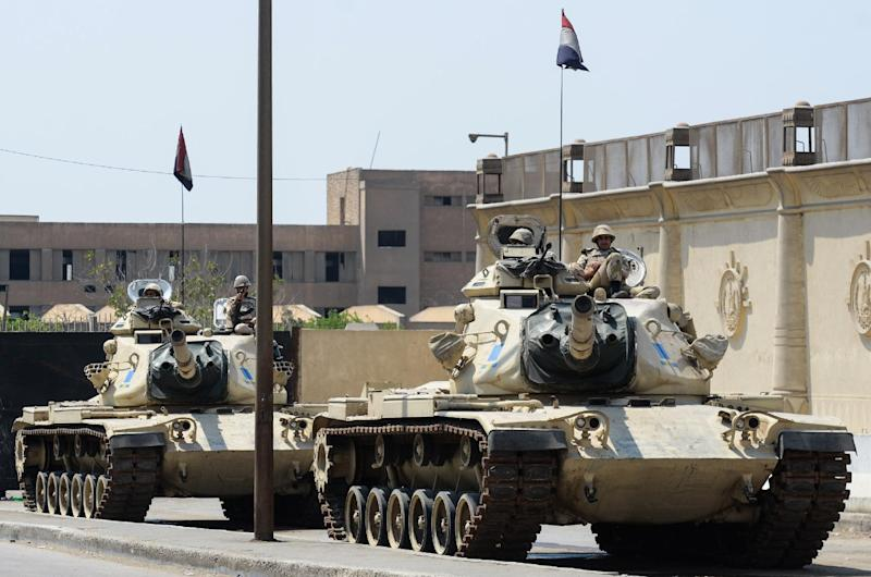 Egyptian military tanks are positioned outside the police institute, Cairo, on April 10, 2014