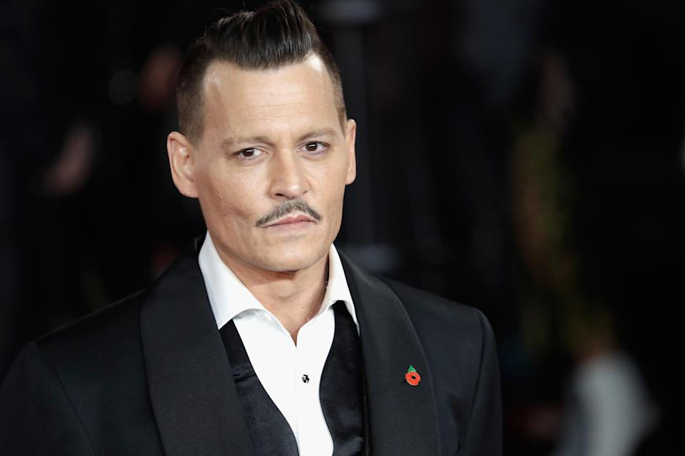 Johnn Depp was sued for allegedly punching a crew member on the set of his Notorious BIG film City of Lies