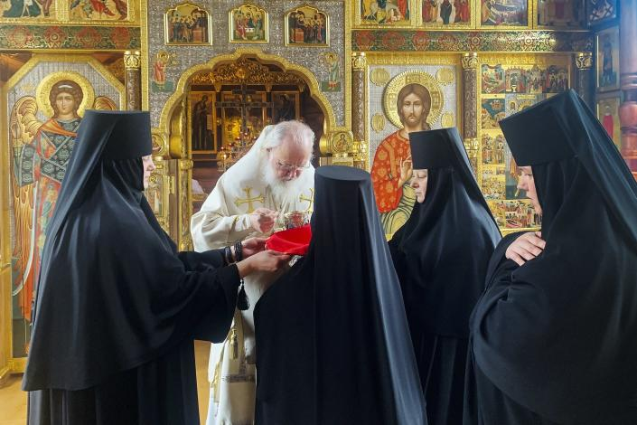 Orthodox nuns queue for communion from Russian Orthodox Church Patriarch Kirill, center, after a Great Saturday Mass in a church in Moscow, Russia, Sunday, April 12, 2020. The Russian Orthodox Church says it will hold Easter services in Moscow without parishioners in conformance with an order from the city's chief epidemiologist to prevent the spread of the coronavirus. For Orthodox Christians, this is normally a time of reflection, communal mourning and joyful release, of centuries-old ceremonies steeped in symbolism and tradition. But this year, Easter - by far the most significant religious holiday for the world's roughly 300 million Orthodox - has essentially been cancelled. (Sergei Zaikin, Russian Orthodox Church Press Service)