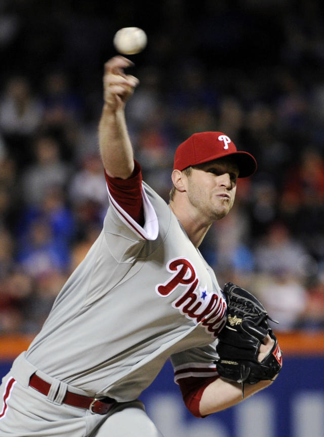 Philadelphia Phillies pitcher Kyle Kendrick delivers the ball to the New York Mets during the first inning of a baseball game on Saturday, May 10, 2014, at Citi Field in New York. (AP Photo/Bill Kostroun)