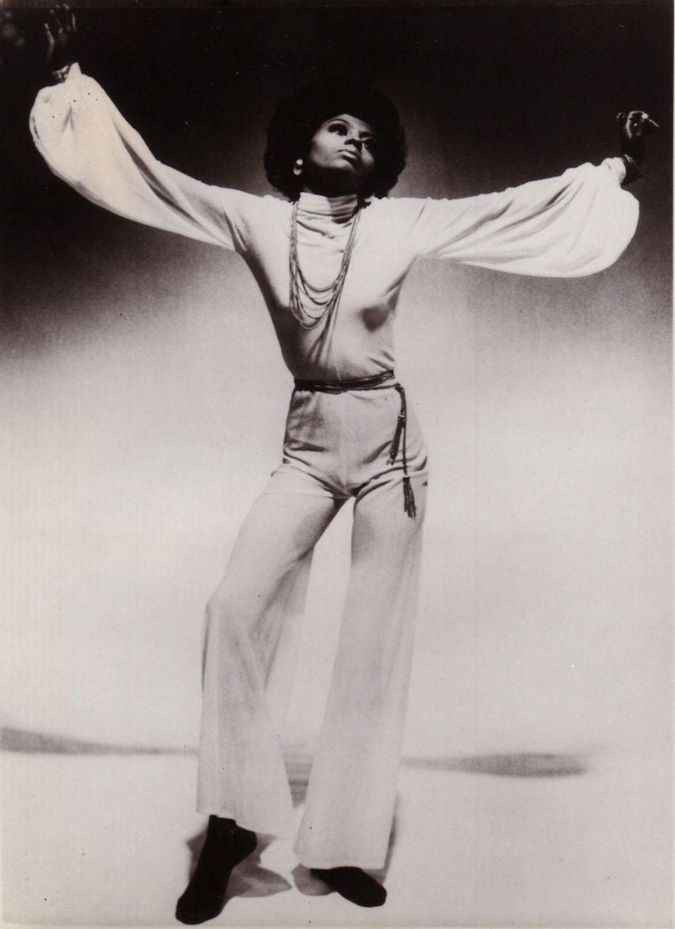<p>After the Supremes's name changed to Diana Ross and the Supremes, Ross ended up going solo in 1970. Here, she poses for a studio shoot in a bohemian blouse and wide-legged matching pants.<br></p>