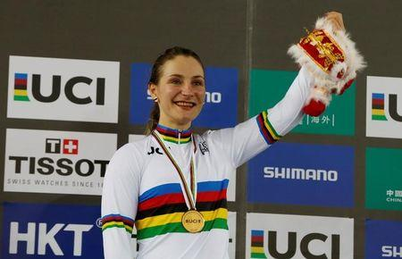 Cycling - UCI Track World Championships - Women's Sprint, Final - Hong Kong, China - 14/4/17 - Germany's Kristina Vogel poses with gold medal and a toy.   REUTERS/Bobby Yip