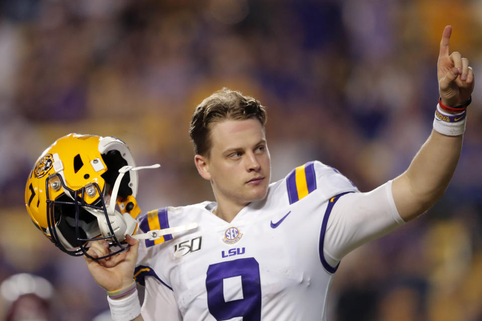 LSU quarterback Joe Burrow, who is considered a frontrunner for the Heisman Trophy, acknowledges the crowd as he is pulled from his last game in Tiger Stadium, in the fourth quarter of the team's NCAA college football game against Texas A&M in Baton Rouge, La., Saturday, Nov. 30, 2019. LSU won 50-7. (AP Photo/Gerald Herbert)