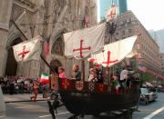 """FILE - In this Oct. 14, 1996 file photo, a model of the """"Santa Maria,"""" one of Christopher Columbus' three ships, is pulled up New York's Fifth Avenue in front of St. Patrick's Cathedral during the 56th Columbus Day Parade. Columbus Day became a national holiday in 1968, endorsed by Congress and President Lyndon Johnson as a tribute to immigrants and as a """"declaration of willingness to face with confidence the imponderables of unknown tomorrows,"""" according to a Senate report at the time. But over the past 40 years, as Columbus' image has shifted from the """"discoverer of America"""" to that of a racist and imperialist, some cities and states have either changed the holiday's name or used the day to honor others. (AP Photo/Marty Lederhandler, File)"""
