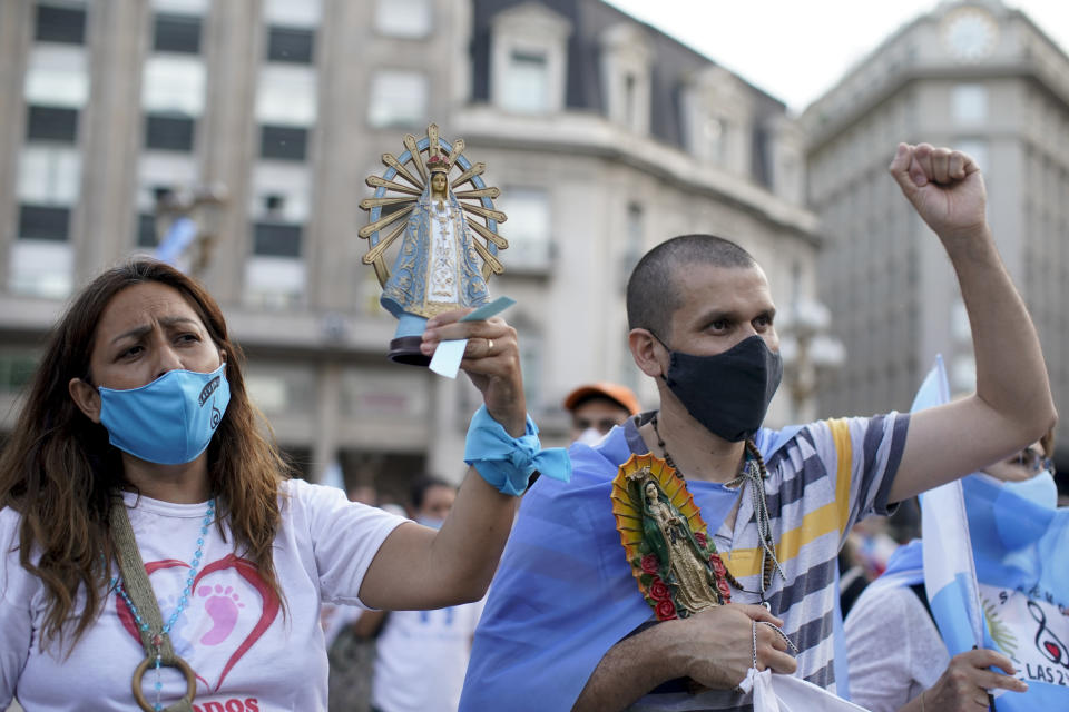 Activists protest against the decriminalization of abortion, one day before lawmakers will debate its legalization, at Plaza de Mayo in Buenos Aires, Argentina, Monday, Dec. 28, 2020. (AP Photo/Victor R. Caivano)
