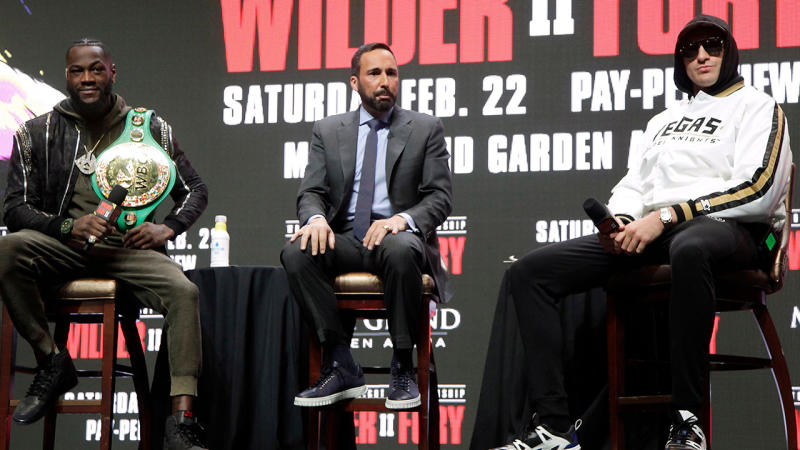Deontay Wilder and Tyson Fury, pictured here discussing their bout at a press conference.