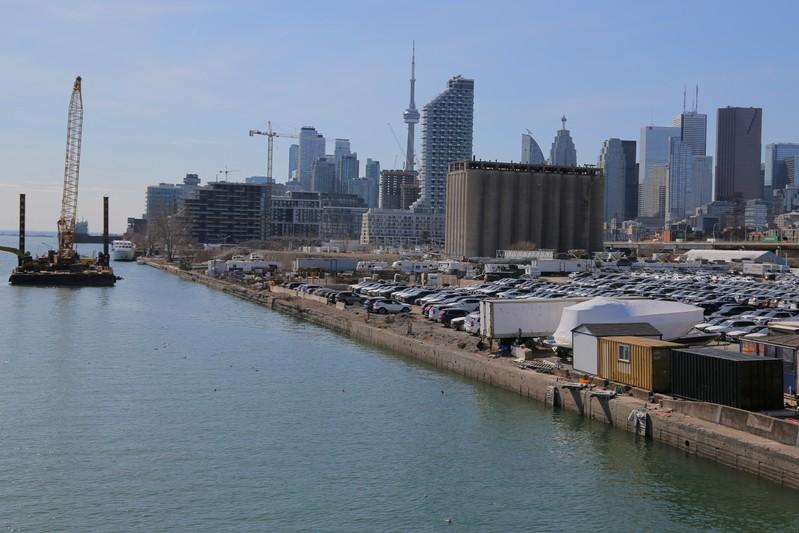 FILE PHOTO: The downtown skyline and CN Tower are seen past the eastern waterfront area of Toronto