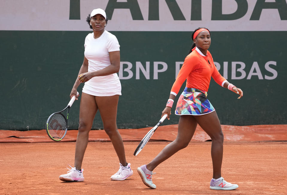 Venus Williams, left with doubles partner Coco Gauff of the United States prepare to play against EllenPerez of Australia and Saisai Zheng of China in a first round women's doubles match day four of the French Open tennis tournament at Roland Garros in Paris, France, Wednesday, June 2, 2021. (AP Photo/Michel Euler)