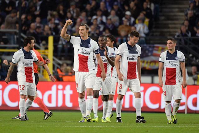 PSG player Zlatan Ibrahimovic, 2nd left, celebrates with teammates after scoring a hatt rick against RSC Anderlecht during their Group C Champions League soccer match in Brussels on Wednesday, Oct. 23, 2013. (AP Photo/Geert Vanden Wijngaert)