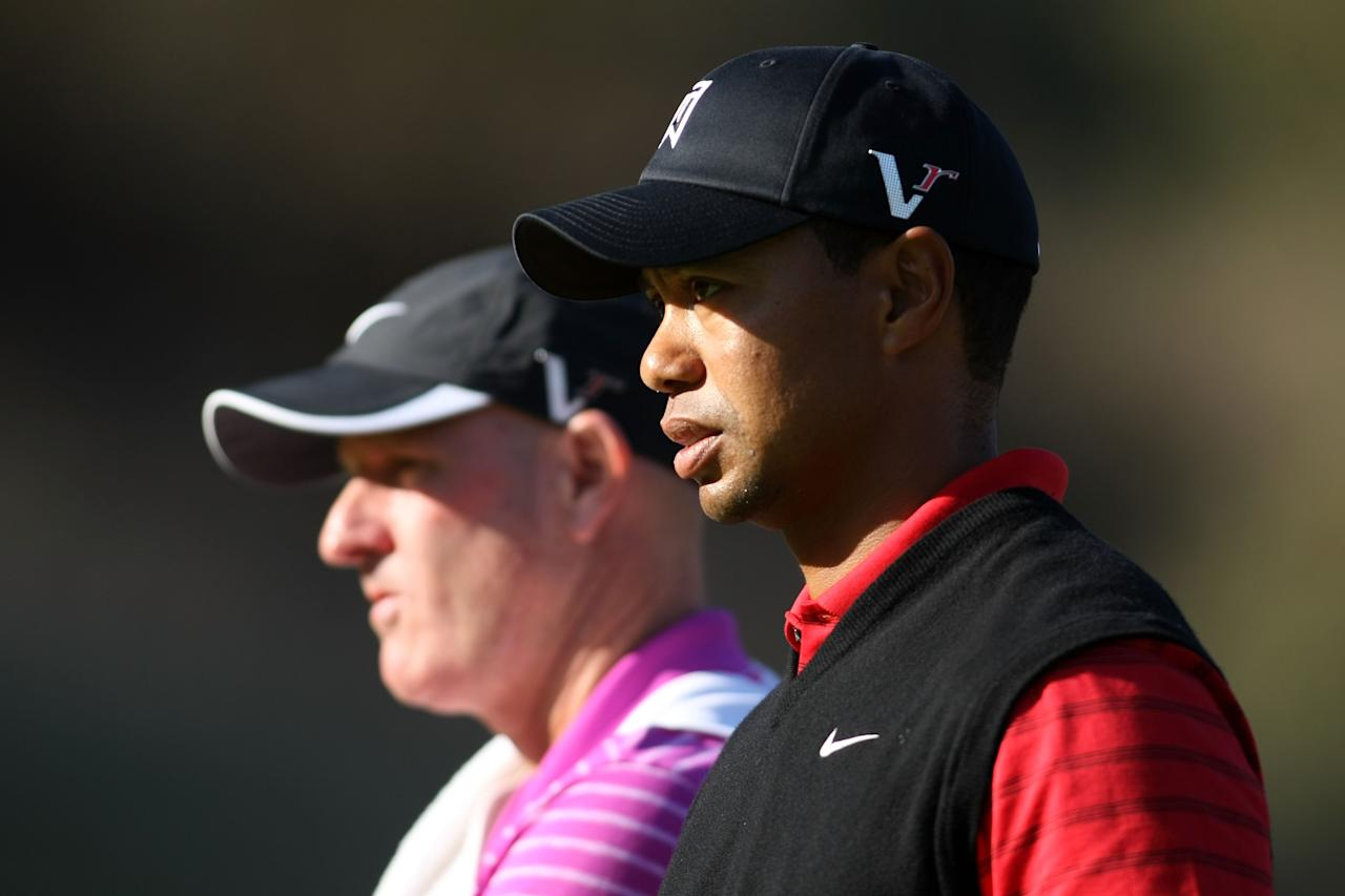 THOUSAND OAKS, CA - DECEMBER 04:  Tiger Woods stands with his caddie on the Joe Lacava during the final round of the Chevron World Challenge at Sherwood Country Club on December 4, 2011 in Thousand Oaks, California.  (Photo by Robert Meggers/Getty Images)