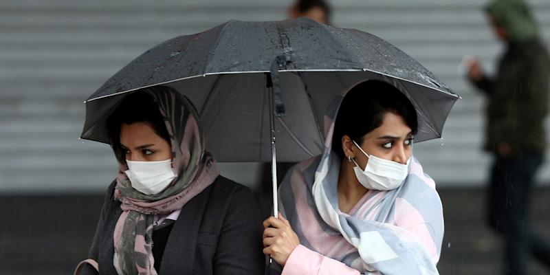 FILE PHOTO: Iranian women wear protective masks to prevent contracting coronavirus, as they walk in the street in Tehran, Iran February 25, 2020. WANA (West Asia News Agency)/Nazanin Tabatabaee via REUTERS