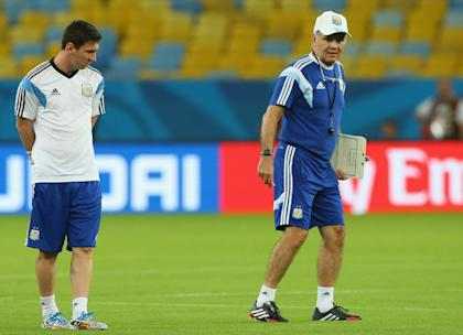Alejandro Sabella instructs Lionel Messi during practice at Maracana Stadium on Saturday. (Getty Images)