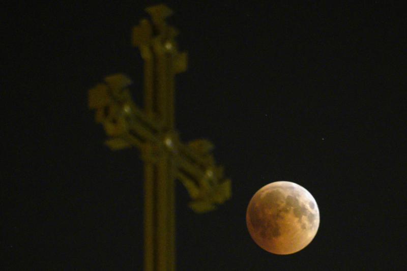 The moon passes over an Armenian Apostolic Church cathedral in Yerevan. (KAREN MINASYAN via Getty Images)