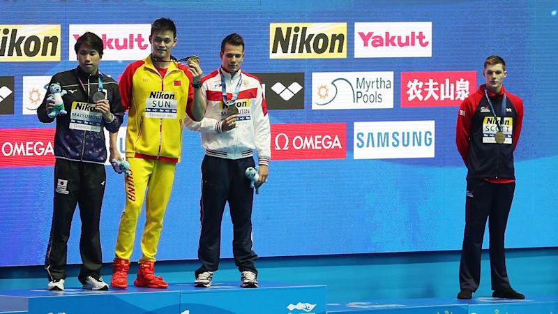 Duncan Scott (far right) didn't take the podium with Sun Yang after the 200m final. Image: Getty