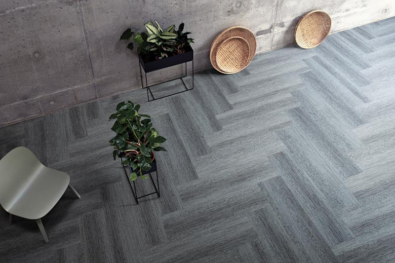 Interface carpet tile in herringbone.