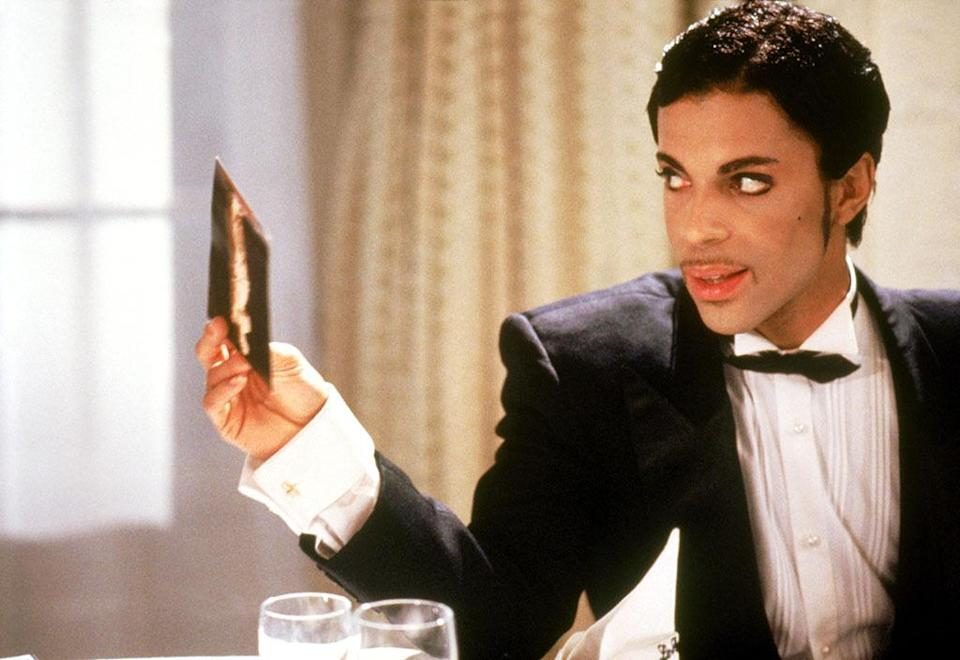 """<p>Prince parlayed the success of <i>Purple Rain </i>into this concept record of a feature film: a black-and-white European pastiche about a pair of con men plying their trade along the French Riviera when one of them falls in love with Kristin Scott Thomas. The music, not surprisingly, is great. The movie is like an album cover come to baffling life. <a href=""""https://www.youtube.com/watch?v=IwkqXsWPY1k"""" rel=""""nofollow noopener"""" target=""""_blank"""" data-ylk=""""slk:Watch the Trailer"""" class=""""link rapid-noclick-resp"""">Watch the Trailer</a> <i>(Photo: Everett Collection)</i></p>"""