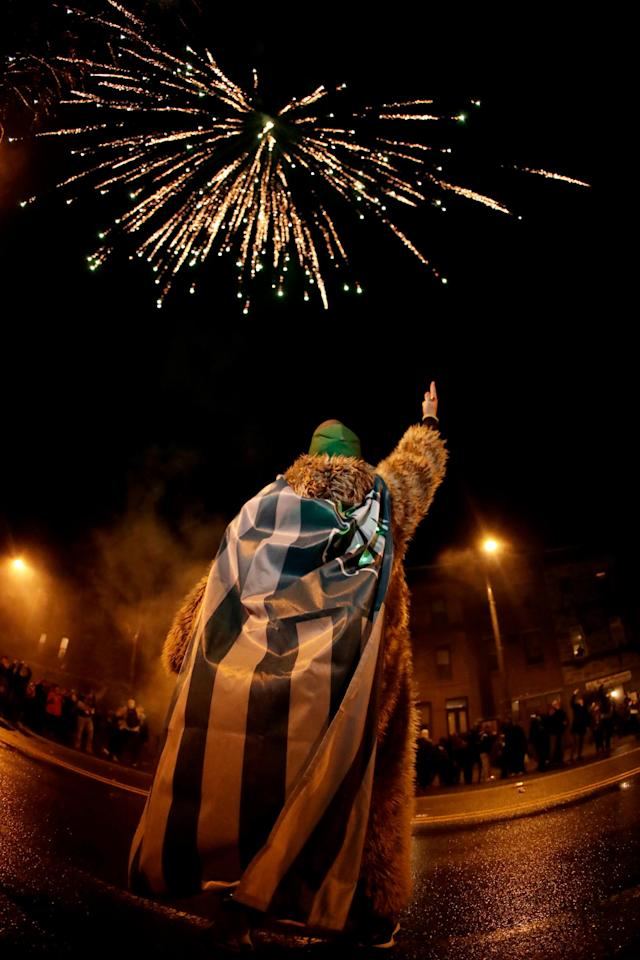 <p>A Philadelphia Eagles fan celebrates the team's victory in the NFL Super Bowl 52 football game between the Philadelphia Eagles and the New England Patriots, Sunday, Feb. 4, 2018, in downtown Philadelphia. (AP Photo/Julio Cortez) </p>