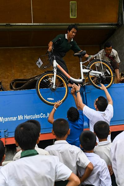 Mandalay entrepreneur Mike Than Tun Win bought up cycles from bike-sharing companies who had pulled out of Singapore and Malaysia (AFP Photo/Ye Aung THU)
